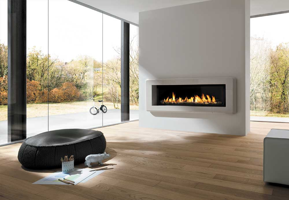 The Infinite gas fireplace and Milano mantle made from honed and polished Bianco Mediterraneo marble